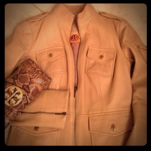 Tory Burch Leather Jacket Authentic Tory Burch buttery soft leather jacket in Camel color & with gold logo buttons.  Zippers on sleeve cuff, pocket on left arm.  Size 4.  In excellent condition but has a tiny pen mark on the left shoulder side.  Not recommended for big breasted ladies. Tory Burch Jackets & Coats
