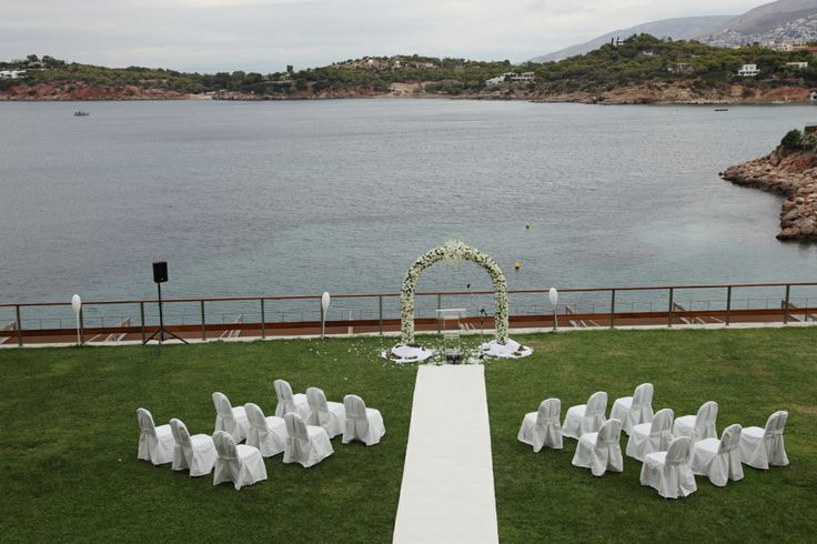 Exchange of vows | Vouliagmeni Keyhole View: Exquisite tailor-designed ultra chic wedding reception with tremendous sea view.