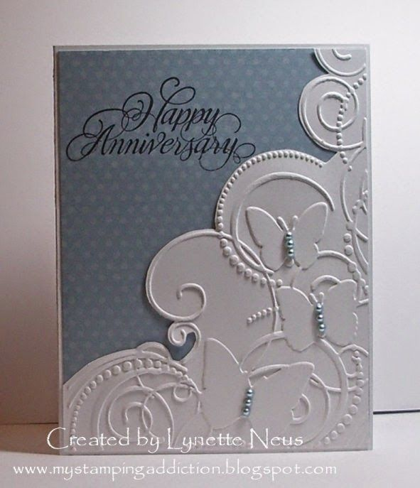 """My Stamping Addiction: Embossed Butterflies: She embossed white paper in the Darice """"Butterflies"""" folder, then cut down the piece along the top edge & added pearls to the butterflies."""