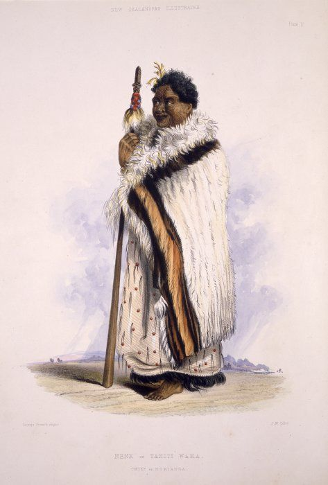 Standing portrait of Maori chief of Hokianga Tamati Waka Nene, in full Maori dress, with moko, and holding a taiaha. He is standing against an extensive landscape background.