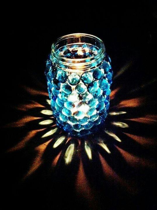 Empty clean glass jar & flat bottomed colored beads glued to it... then just add a candle! Beautiful!