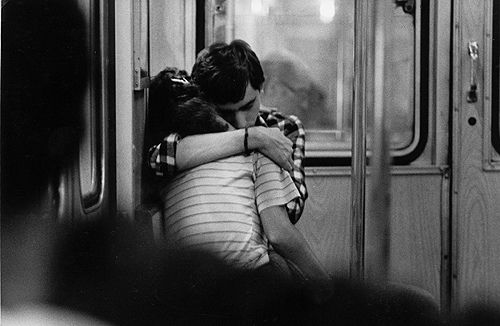 "Subway. Buenos Aires (by Daniel Merle)  ""In transit. I saw them. Just two kids in love. I got my 135 mm and made one shot"""