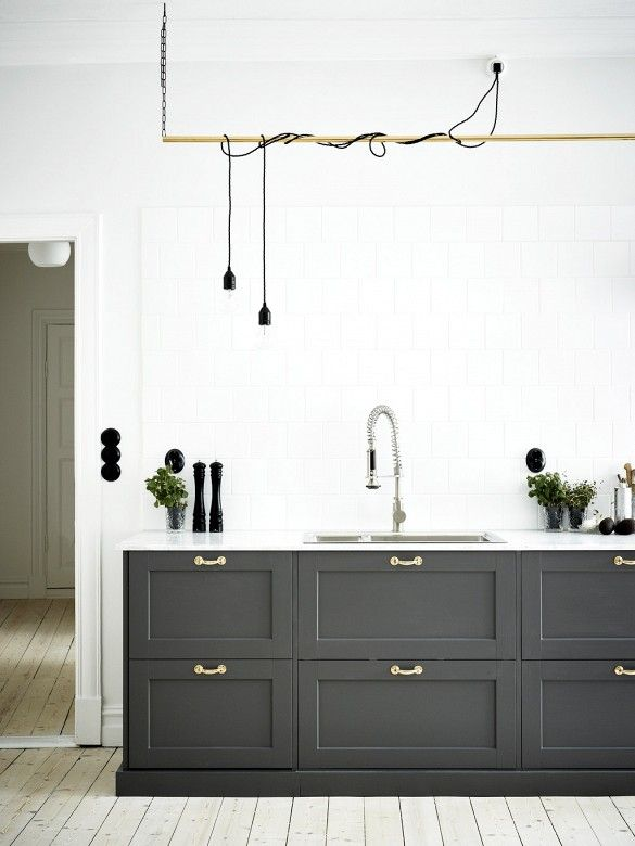 This masculine kitchen features some industrial elements, like pipe and cord…