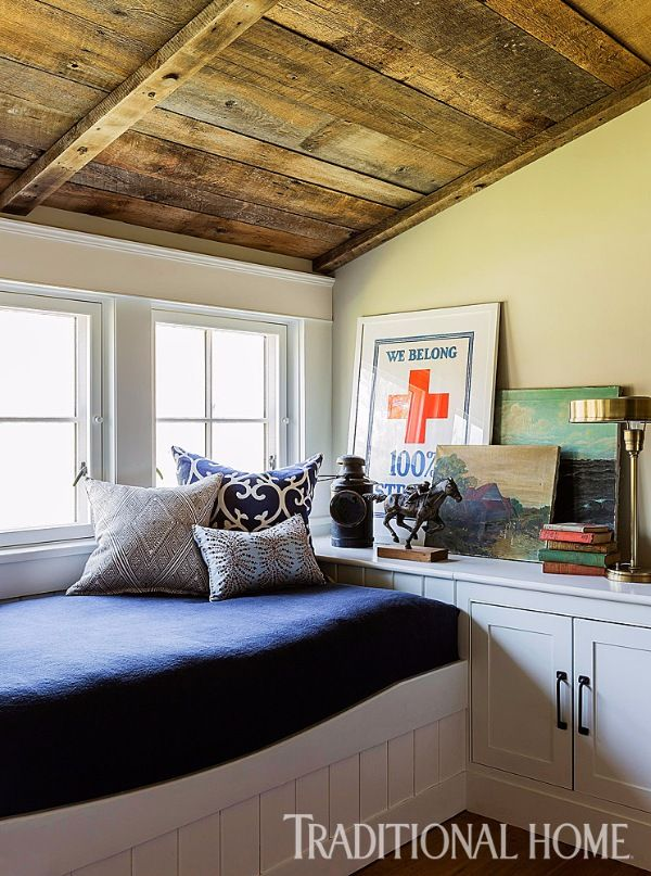 A built-in daybed perfect for curling up with a good book finds a home amongst the many nooks and crannies this farmhouse offers. - Photo: Michael Lee / Design: Jill Goldberg