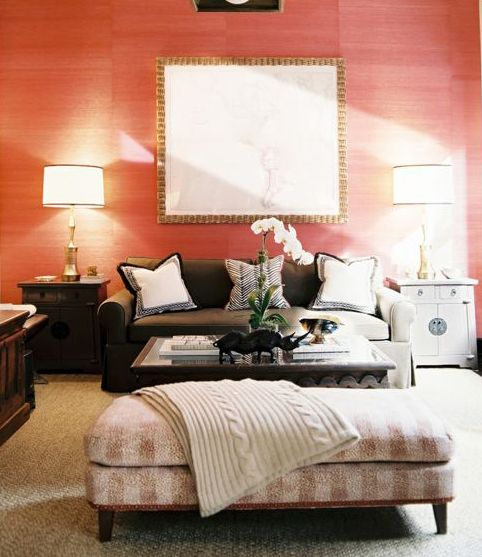 not in love with the way this room is styled, but the coral grasscloth with touches of gold/brass is pretty great