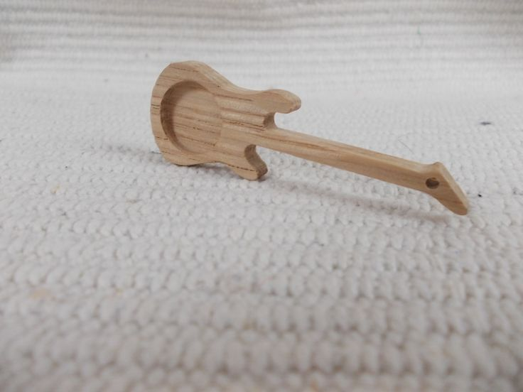 unfinished guitar-shaped pendant base with 18 mm round cutout https://www.etsy.com/listing/601119675/new-1-p-unfinished-guitar-shaped-pendant?ref=shop_home_active_12