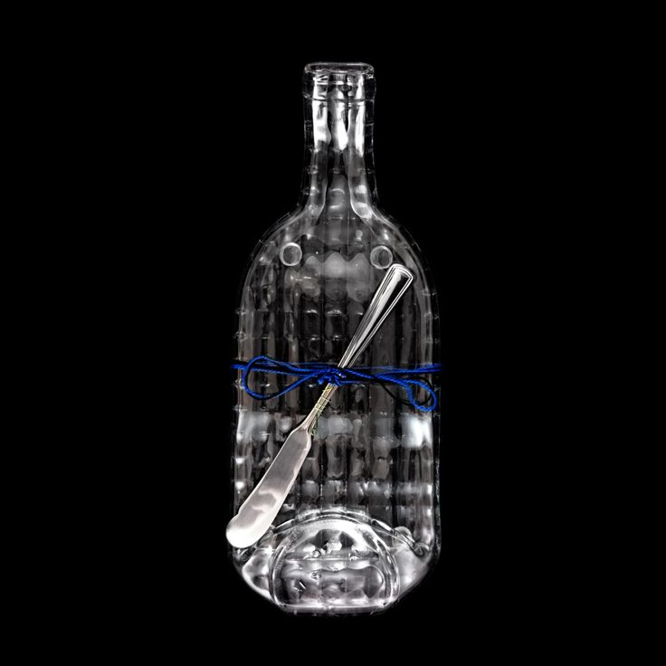 Clear square patterned wine bottle with a curved neck.  Unique detailing makes this bottle extra unique!  Must have for entertaining.