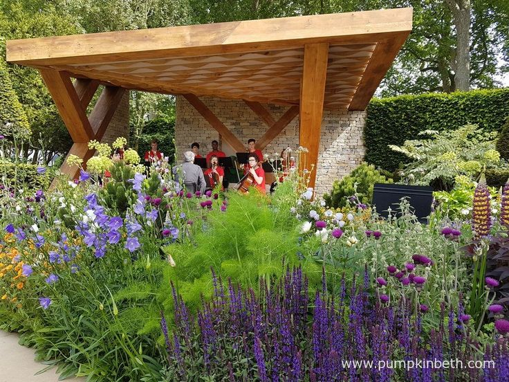 Members of the National Youth Orchestra perform music composed by Lauren Marshal in the loggia on the Morgan Stanley Garden. The Morgan Stanley Garden was designed by Chris Beardshaw, for the RHS Chelsea Flower Show 2017.