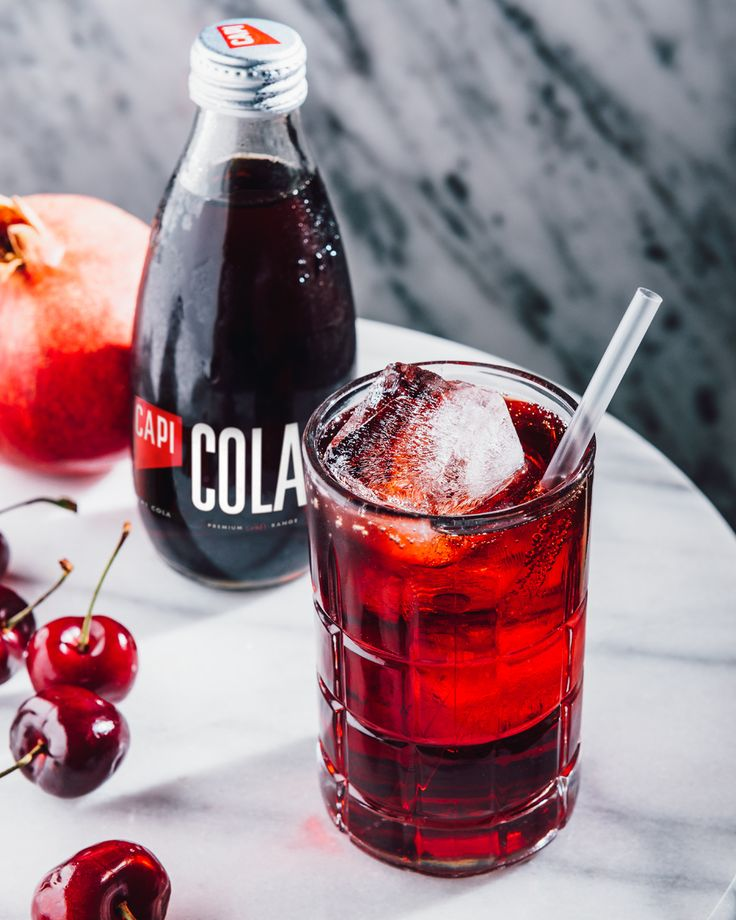 Feeling a little cheeky? Why not slip some luscious cherry brandy into your CAPI Cola? Like an elegant red dress, this shining jewel of a cocktail is sure to turn some heads.