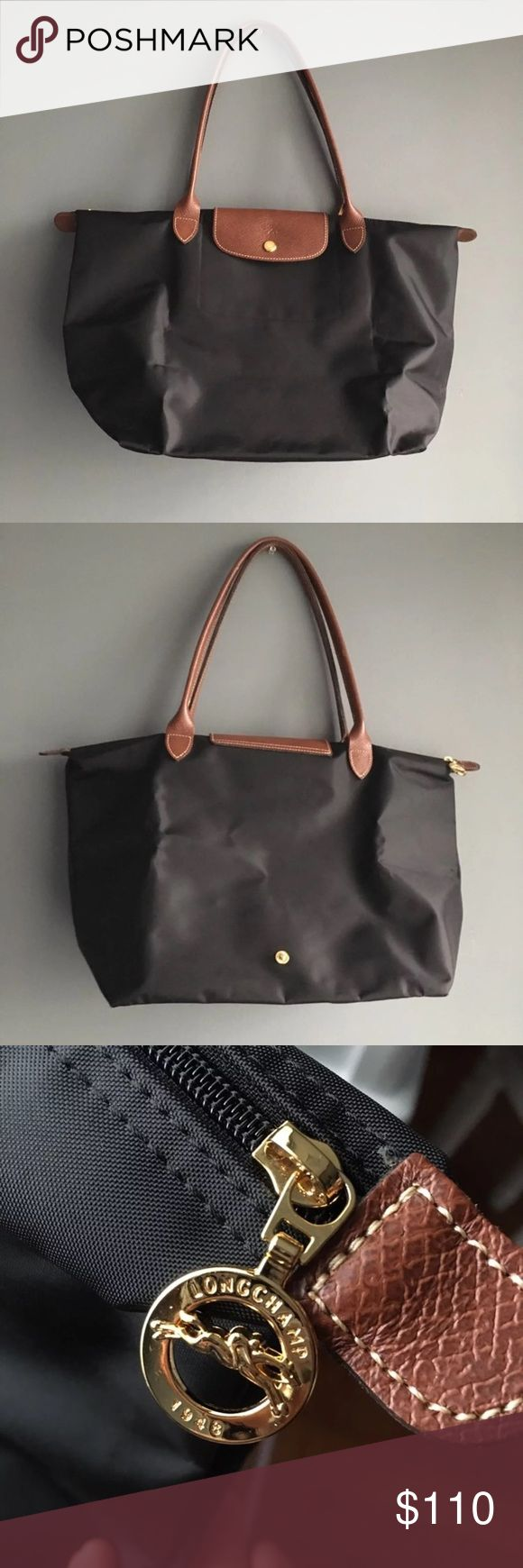 """Longchamp Le Pliage large tote Authentic. Excellent preused condition. Creases and faint scuffs on exterior, faint crease or scuff on interior & one tiny scuff peel on handle. 12 1/4 """" W x 11 3/4 """" H x 7 1/2 """" D. 9"""" strap drop. Top zip closure with outer snap tab. Interior wall pocket. Buy as is. Final sale. Final price. Longchamp Bags Totes"""