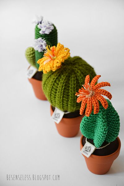 amigurumi crochet cactus in clay pots -