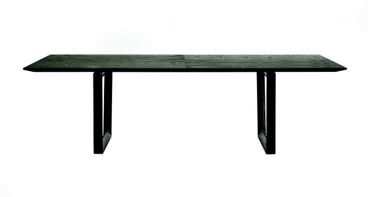 "Roberto Lazzeroni has designed the ""Bolero"" table. Sleek, light lines for the living room."