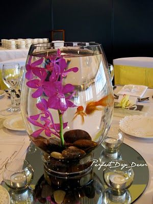 Love the idea of having goldfish in the centrepiece glass bowls as well as the flowers (Frangipani here!) - a great way to entertain your guests, and someone gets to take the fish home with them too! (Otherwise the garden pond...)