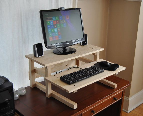 Convert any desk or table into a standing computer desk. This plan will guide you step by step from materials selection to finishing in the color of your choice. The 22 page plan includes complete step-by-step instructions. No prior woodworking experience is required. Much of the plan is devoted to pictures and sketches to take the guesswork out of the process. Total materials cost to build your desk in the US varies from about $25 using standard construction lumber (as shown in the images)…