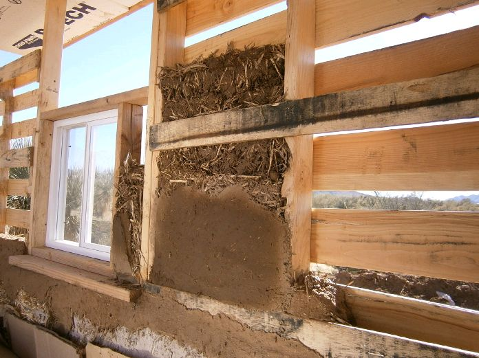 Pallet house with light clay straw insulation.