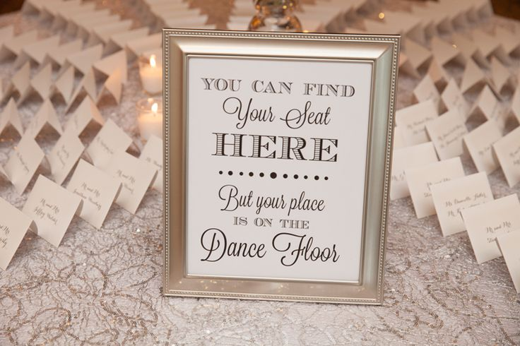 Fun wedding sign ideas: You can find your seat here but your place is on the dance floor (Jeff Kolodny Photography)