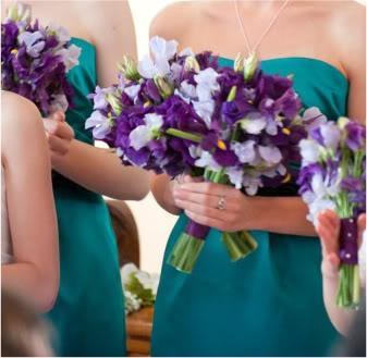 IRIS BOUQUET: Irises, ranunculus, and sweet pea.