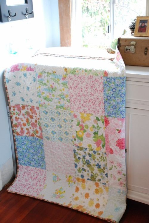 I love vintage sheet quilts... now I have to collect enough vintage sheets to make one for Adeline's big girl room.