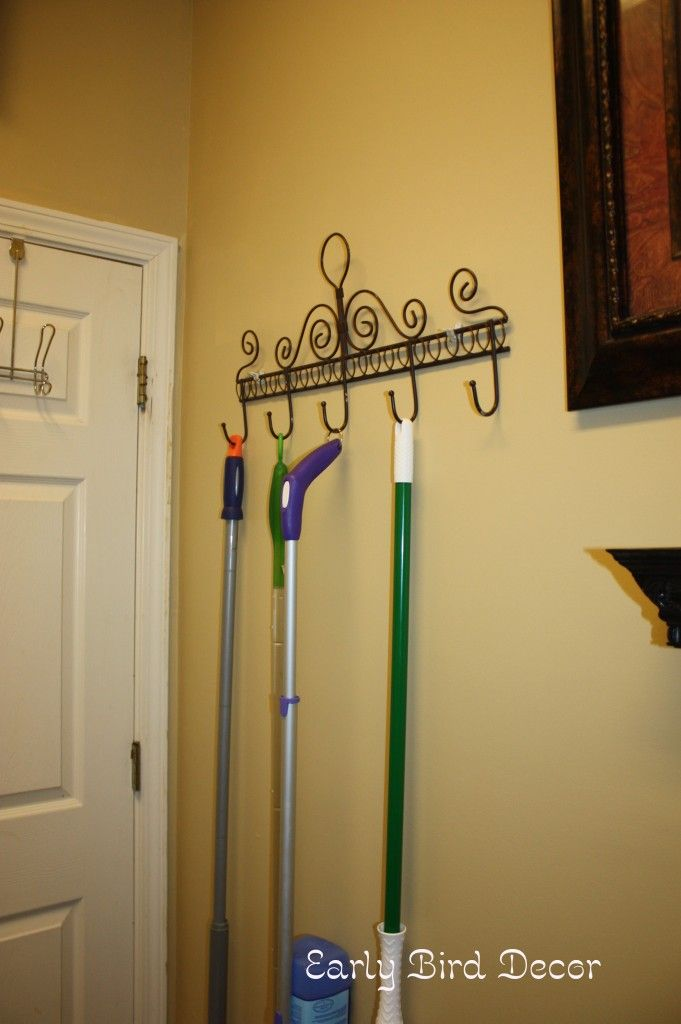 SO simple, why didn't I think of this! Coat rack to hang mop, broom, dust pan, etc. in the Laundry room