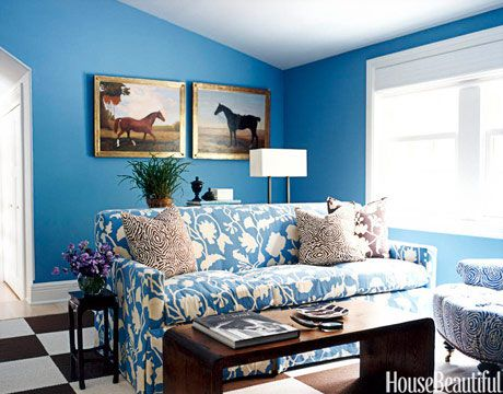 This bright blue study's walls are painted Farrow & Ball's Cook's Blue. The sofa fabric is Potalla by China Seas.