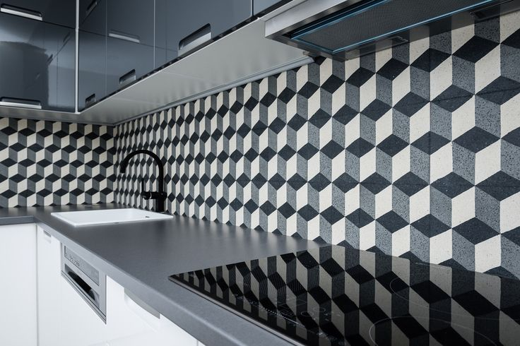 Detail of retro tiles kitchen backsplash