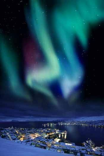 Aurora borealis in Murmansk. It's a port city, located in the extreme northwest part of Russia, on the Kola Bay, an inlet of the Barents Sea on the northern shore of the Kola Peninsula, not far from Russia's borders with Norway and Finland.