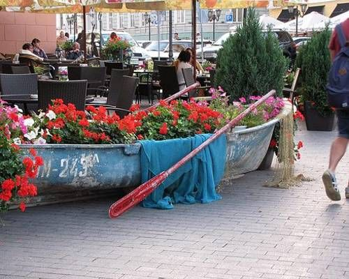 Landscaping ideas to reuse and recycle old boats for yard decorations and unusual containers with flowers are creative, very interesting and surprising