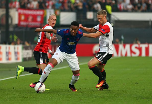 Anthony Martial of Manchester United holds off Rick Karsdorp and Nicolai…
