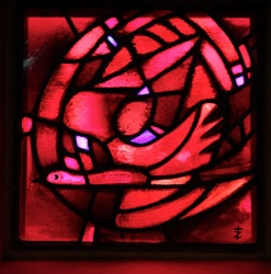 Pentecost stained glass window at the Church of Reconciliation. Taize, France.