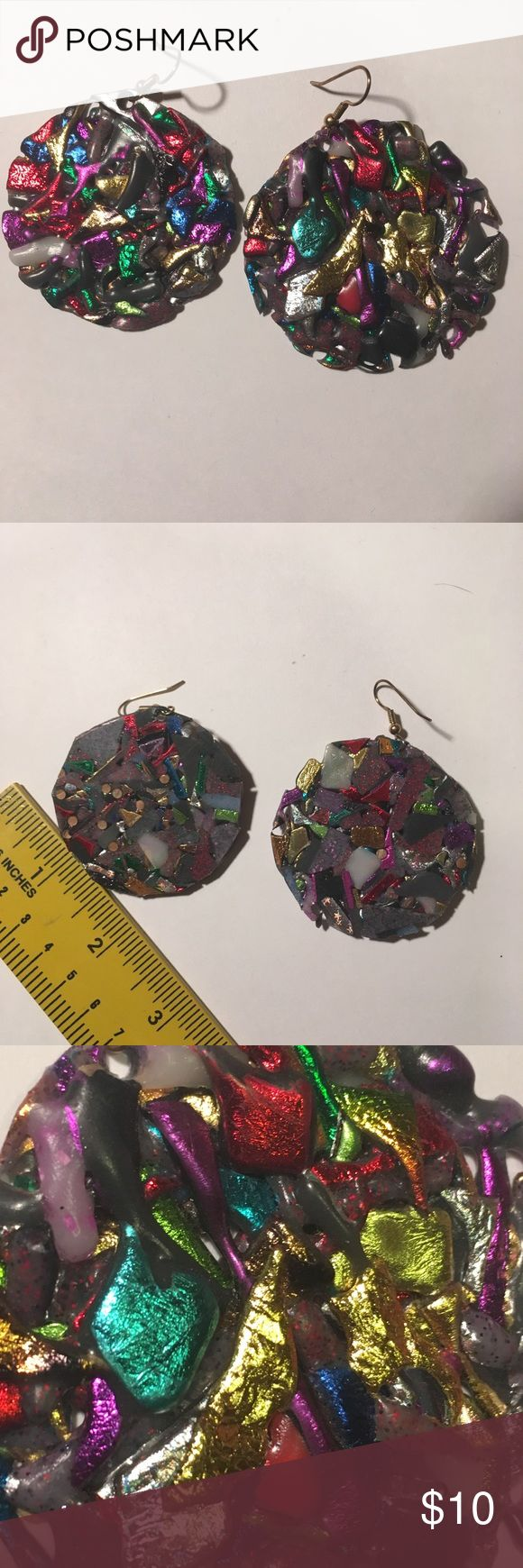Retro Metallic Melted Plastic Round plate earrings The earrings are lightweight melted matte and metallic plastic. Front side is textured, back side is flat. They measure with a two inch diameter. The just make me laugh. Let's just say they get noticed. Jewelry Earrings