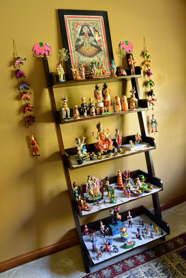 beautiful navrathri golu... (should keep in mind this idea of a ladder book case for golu steps.)