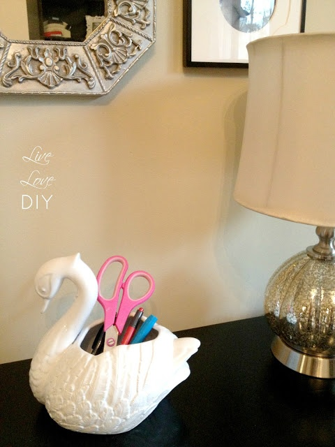 Thrift store ceramics can be painted with High Gloss White Spray Paint.  White Spray Paint Ideas | LiveLoveDIY