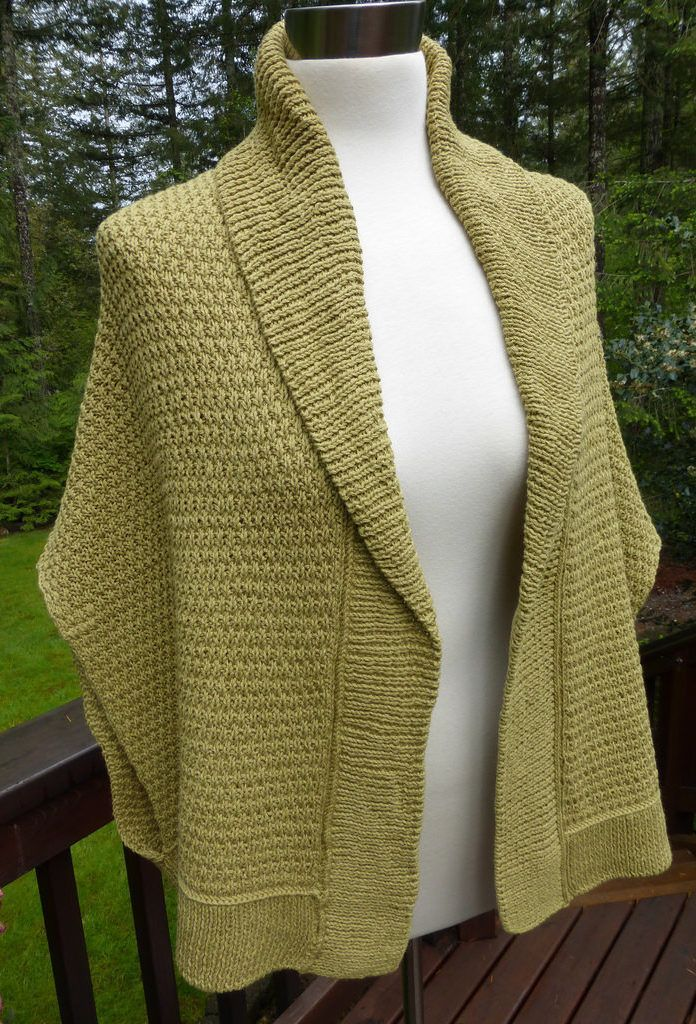 Free Knitting Pattern for Chill Begone Sweater Wrap - This shawl collared cardiganisknit side to side in two pieces and seamed/grafted and then the collar and hem are knit from picked up stitches.Sm/Med and Med/Lrg Designed byLinda Braley