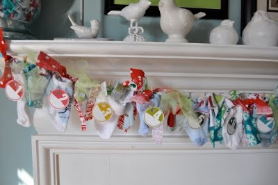 baby socks advent garland, i WILL make this one day when i have little feets