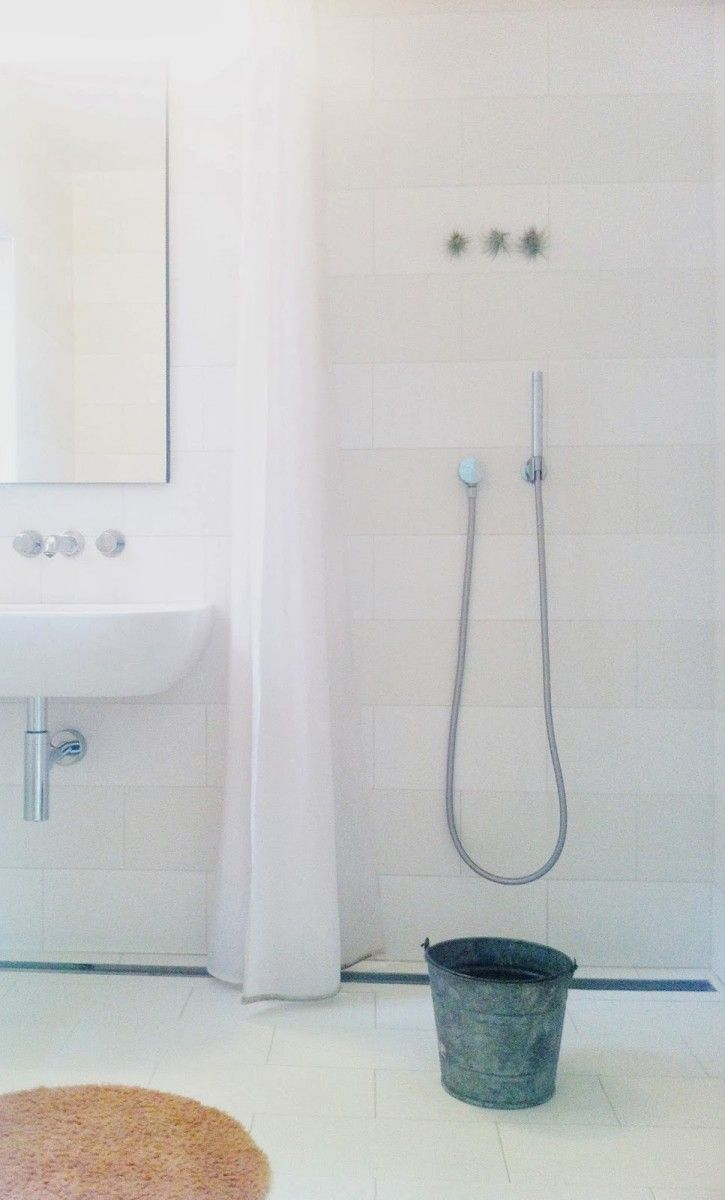 We have a bucket in our shower to collect water while it heats. We use the collected water to flush the adjacent toilet.