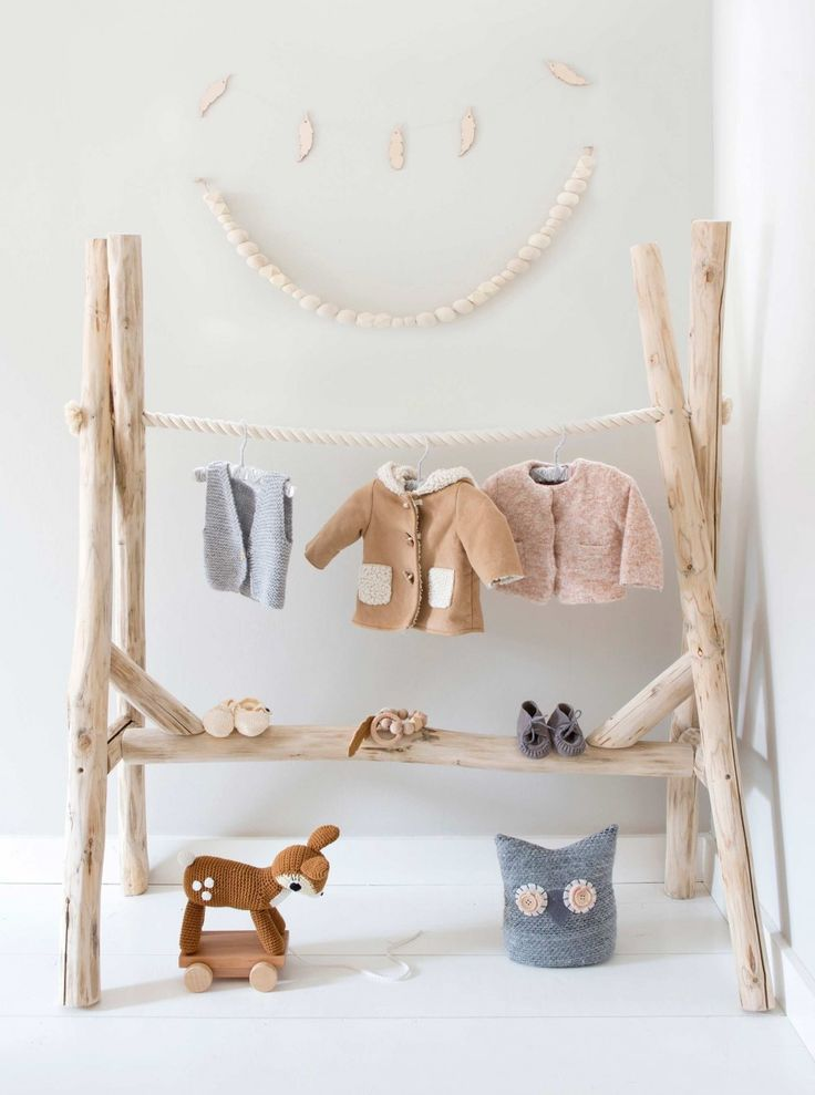 This is an entire mini wardrobe made from branches and rope and it is stunning http://petitandsmall.com/diy-clothes-hangers-babies/
