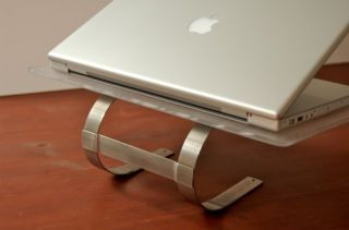 Repurpose an Ikea paper towel holder into a good-looking laptop stand with a drill and some elbow grease