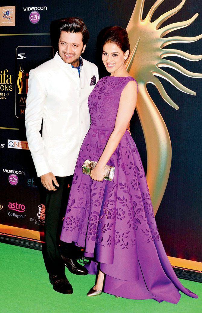 Genelia D'Souza Deshmukh looking elegant in a purple gown by Versace with her husband Deshmukh Riteish at #IIFA2015 in Kuala Lumpur.