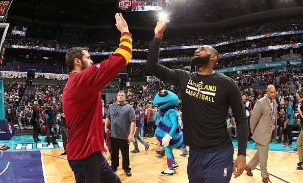 James, Love Help Cavs End 2016 With 121-109 Win Over Hornets | Kevin Love #0 and LeBron James #23 of the Cleveland Cavaliers are introduced before the game against the Charlotte Hornets on December 31, 2016 at Spectrum Center in Charlotte, North Carolina. | A Win to End 2016! | 2017-01-01