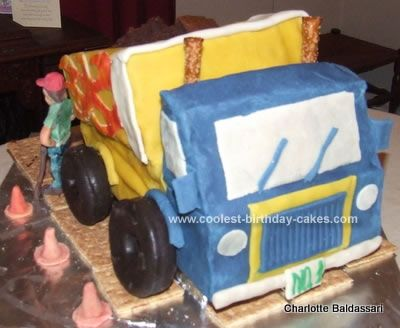 Homemade Dump Truck Cake: I wanted to make a cake for my son's 1st birthday and was inspired by the cute dump truck invitations I found for the party along with ideas from this