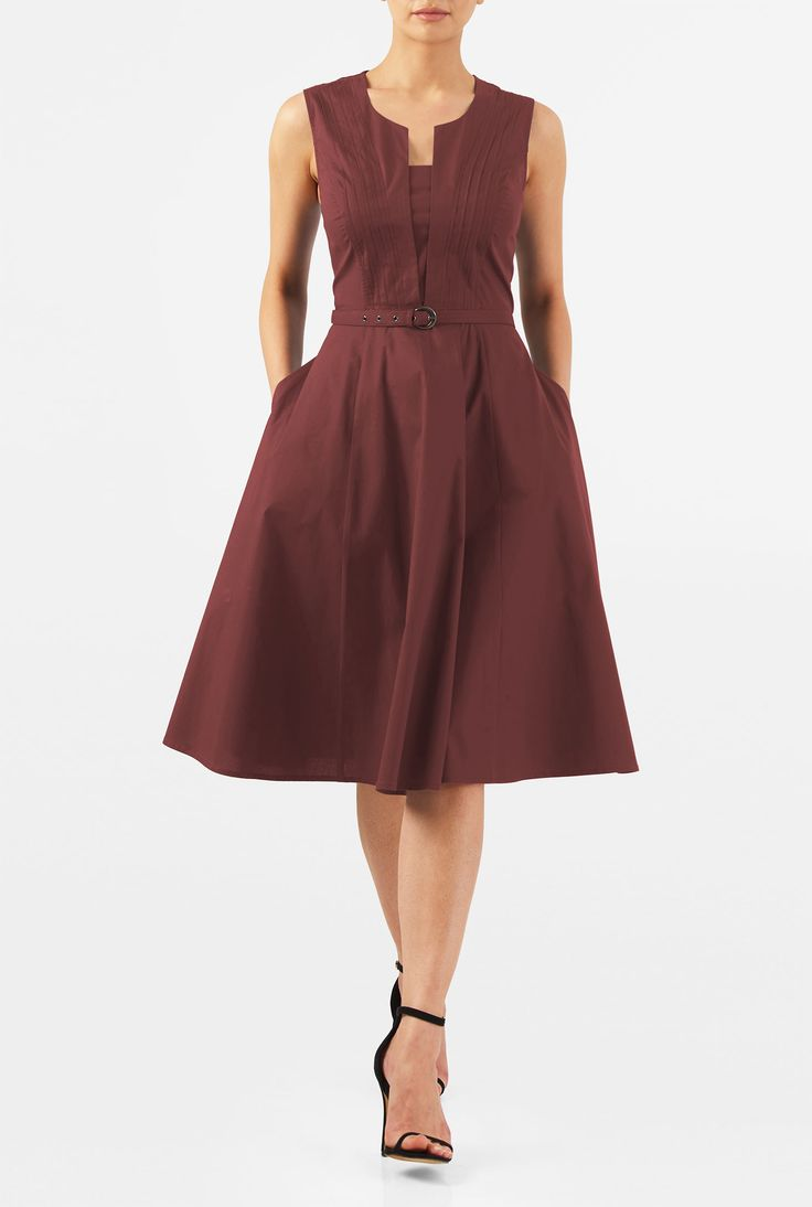 But with a cap sleeve.    A shapely pintuck pleat bodice with a front vent and modesty inset tops our flattering dress crafted from stretch cotton poplin.