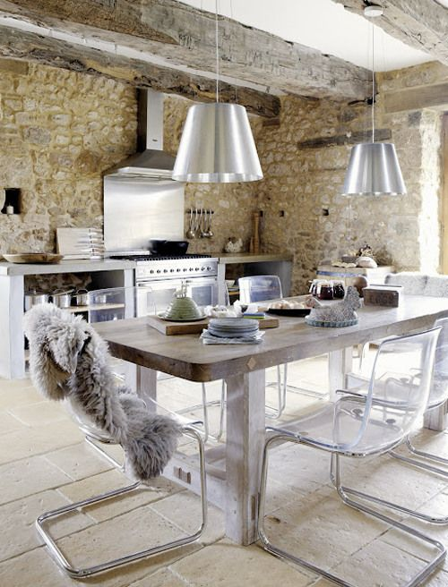 Amazing vintage stone house in France with great combination of vintage and modern or retro. Old stone walls with modern kitchen looks great.