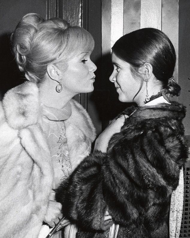 Debbie Reynolds from Carrie Fisher: A Life in Pictures  Both Carrie's parents, including her mother and father Eddie Fisher, we involved in the entertainment industry. Though Carrie tried to escape it when she went off to school in London, she was pulled back in with her first movie in 1975, Shampoo.