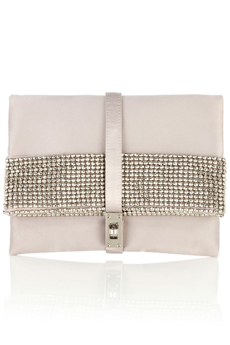 Store all your evening essentials in this satin envelope clutch. The Frida Clutch has been intricately embellished with glass beads for an opulent look. Closed with a silver toned metal front clasp this clutch looks modern when carried effortlessly by hand.