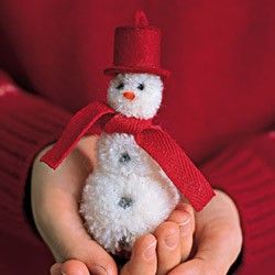 Made of woolly white pom-poms, felt, and ribbon, this frosty friend never has to melt. He makes a great toy for a child; add a loop to the hat, and he becomes an ornament.