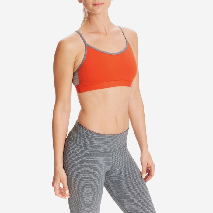 U & Me = Love. The U & Me Yoga Bra is our low impact support, strappy racer back for the active SMOGI. Auromesh lining and Zari Mesh compressive inner liner keeps you secure with every exhale. A thin racerback design, shaped for the full range of motion you need for the studio.