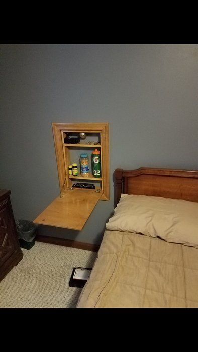 Fold-out bedside table