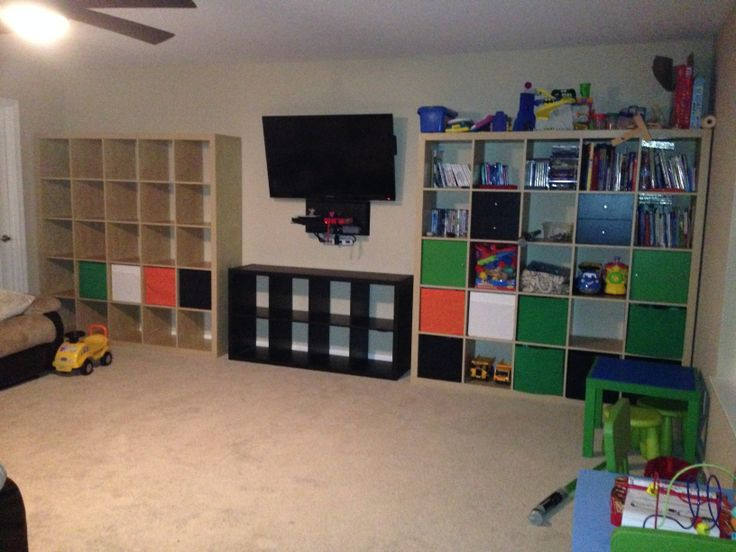 Composed Of Two Ikea Expedit 5x5 Shelves In Faux Beech And One Kallax 2x4 Black Brown With Wall Mounted 42 Television W