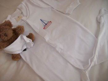 Tom & Bella babygro / sleepsuit with sailing boat embroidered design. http://www.tomandbella.co.za/pS1111/Combed-Cotton-Sleepsuit.aspx