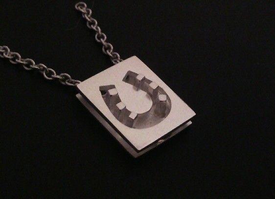 """6-nails"". Silver horse shoe pendant. 10×12,5 mm. Look up Divine Horse Design on facebook."